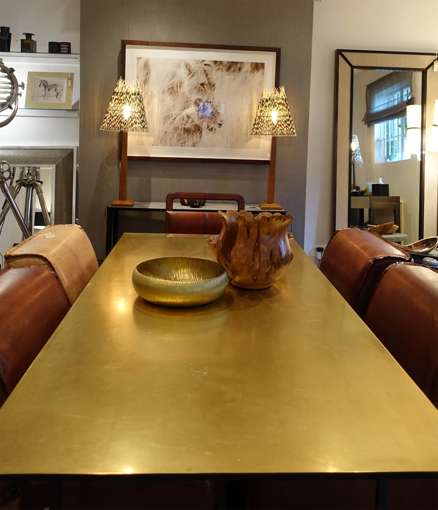 This is the stunning  Brass dining table  surrounded by handmade soft leather  Club chairs .