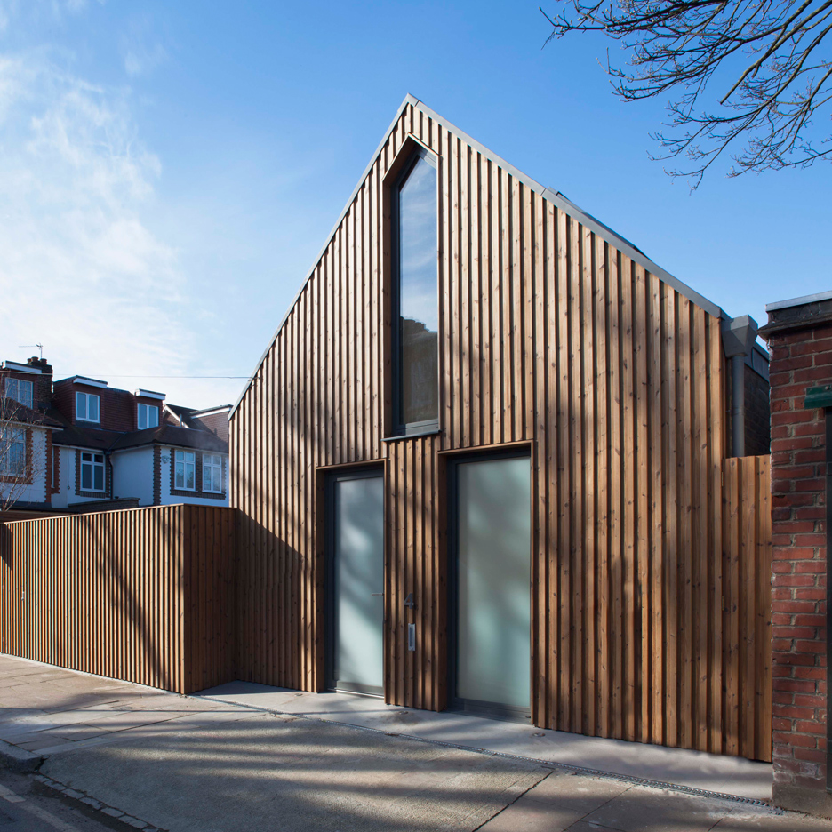 A timber clad house that was built on a tiny plot in South West London by architects Giles Pike.
