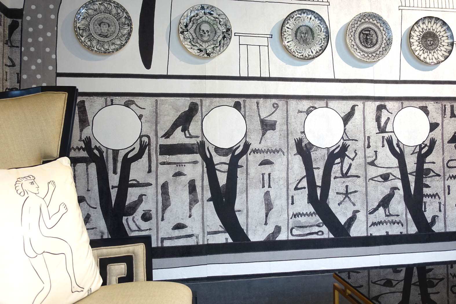 Helen's Memphis wallpaper, Roman Graffiti cushion and plates collection on display.