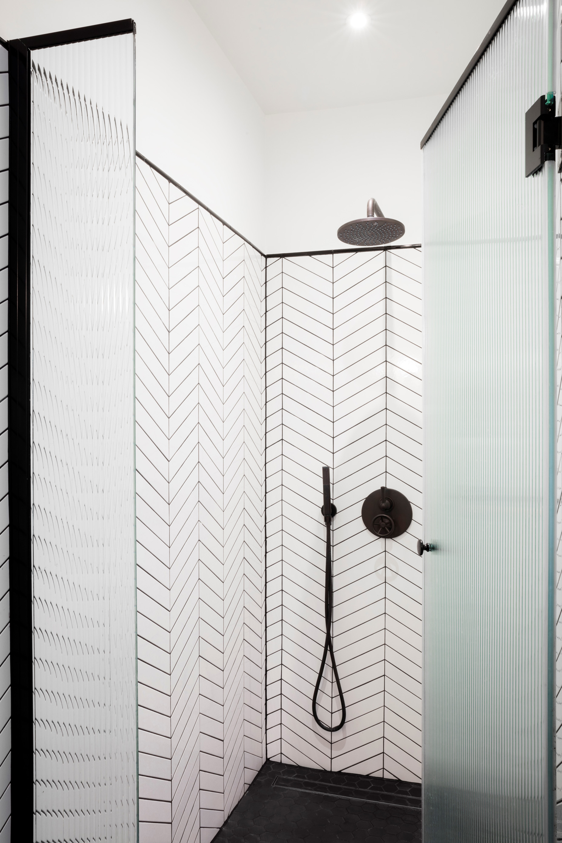 A great way to modernize the bathroom - match your grouting with a shower in 'Gun Metal'