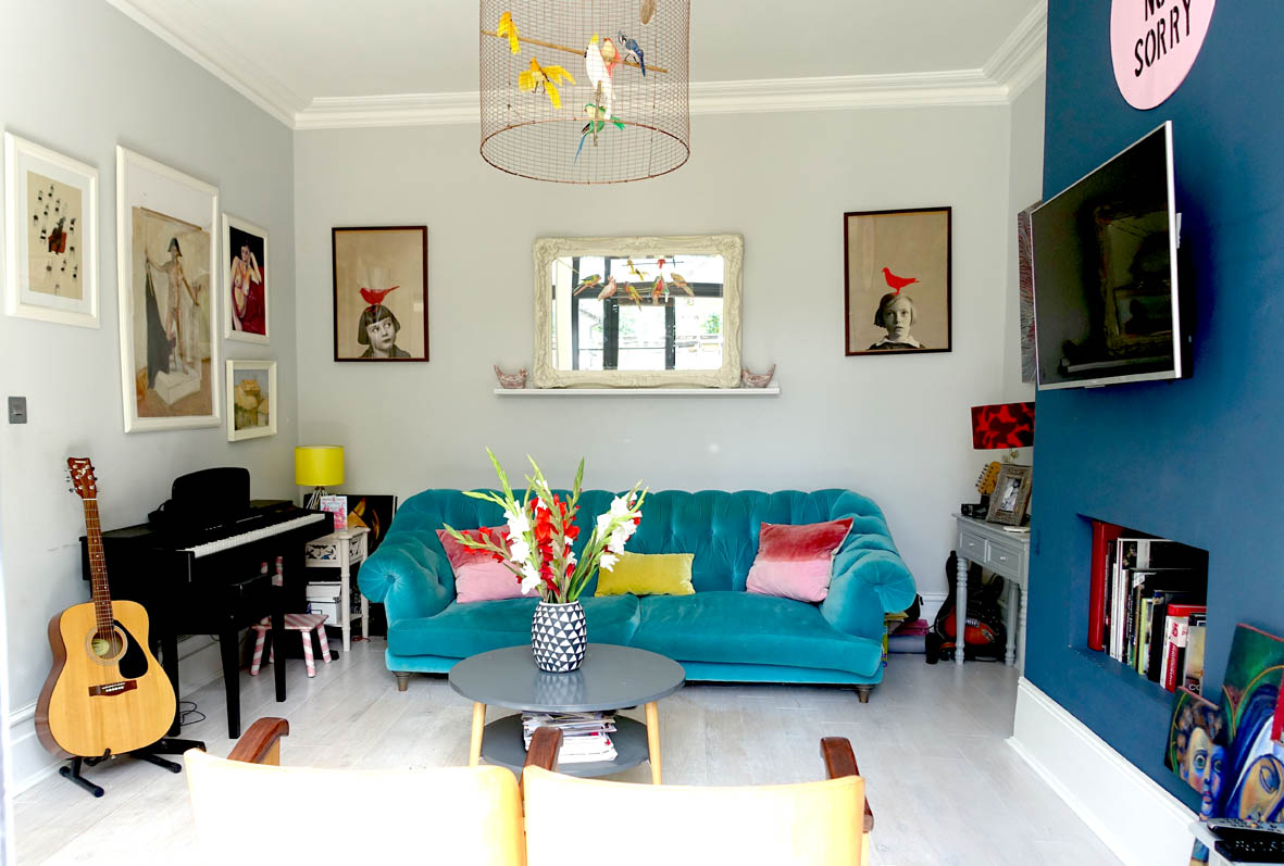 The 'Azure' velvet sofa by Loaf makes a bold statement and is flanked by the 'red bird' posters which were bought for £5 each and framed by Vanessa.
