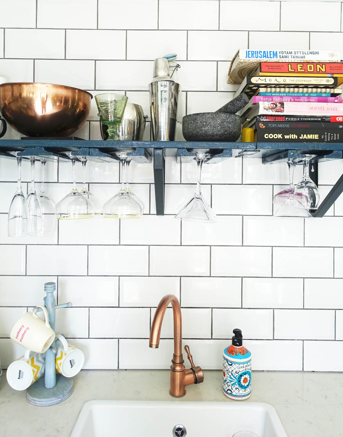 Copper accents stand out against the white tiled background