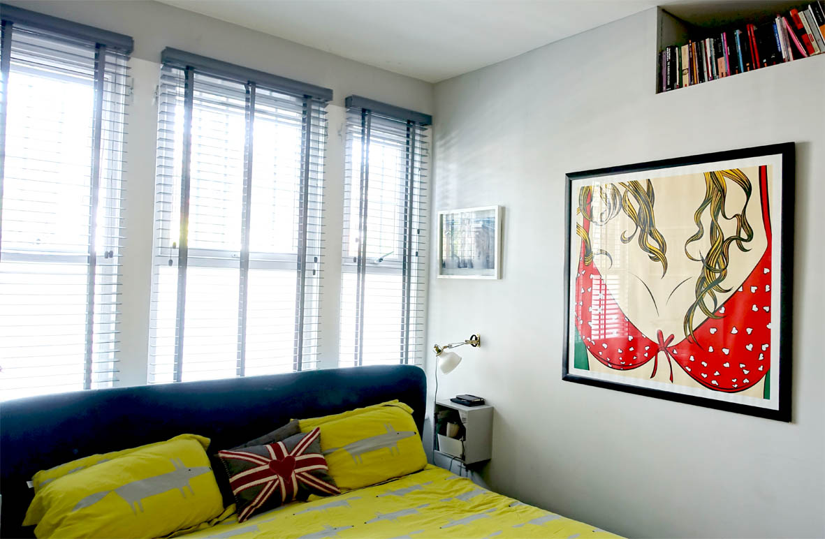 Cheeky artwork and Scion 'Mr Fox' bedding add a sense of fun in the master bedroom.