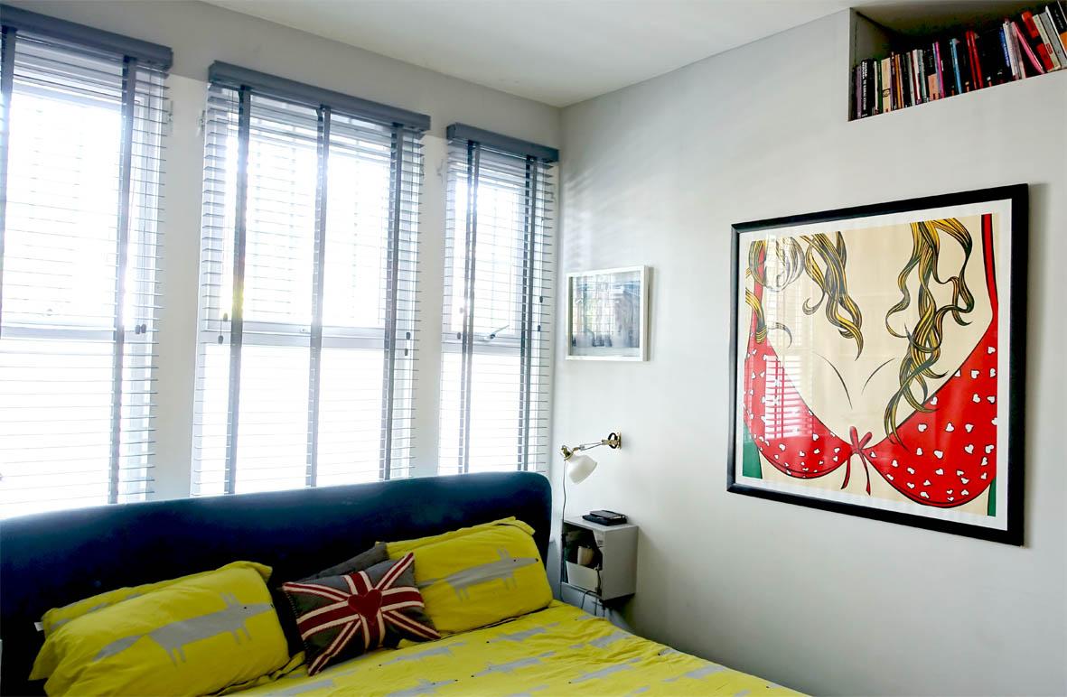 Cheeky artwork and Scion 'Mr Fox' bedding add a sense of fun in the master bedroom.