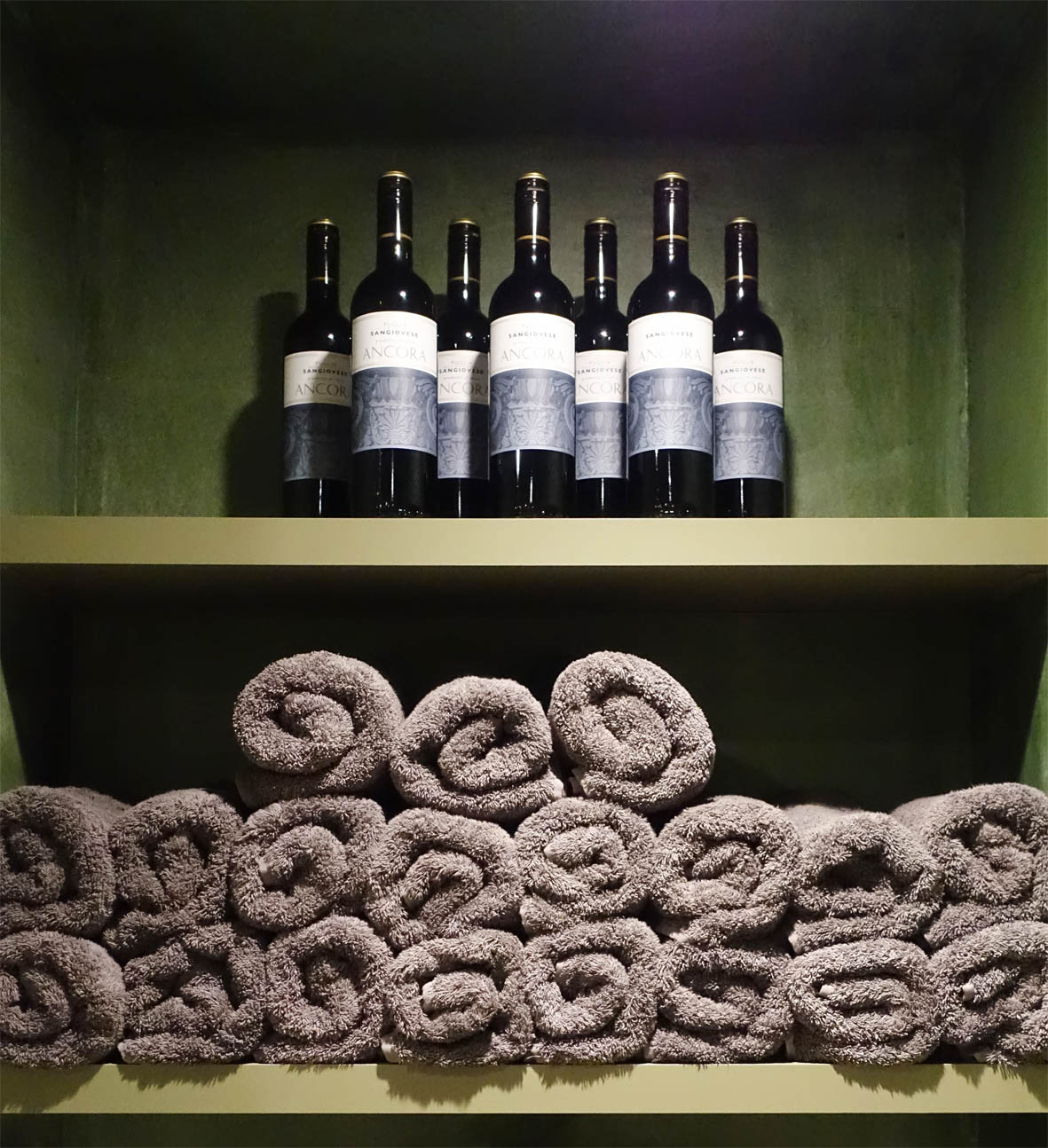 Red wine and soft towels lined up and ready to use for the wine baths