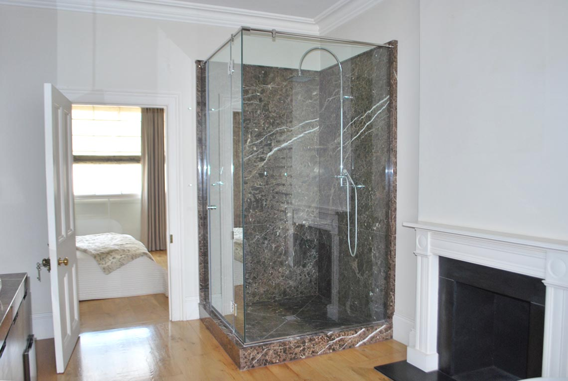 A dramatic marble has been used in the shower and on the countertops.