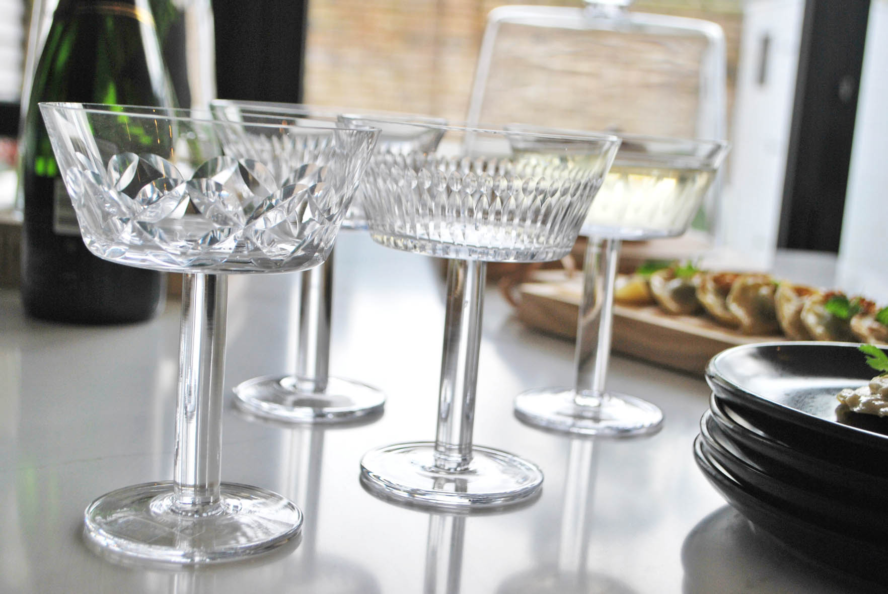 A great detail is that every champagne glass in the set of four has a different cut glass pattern.