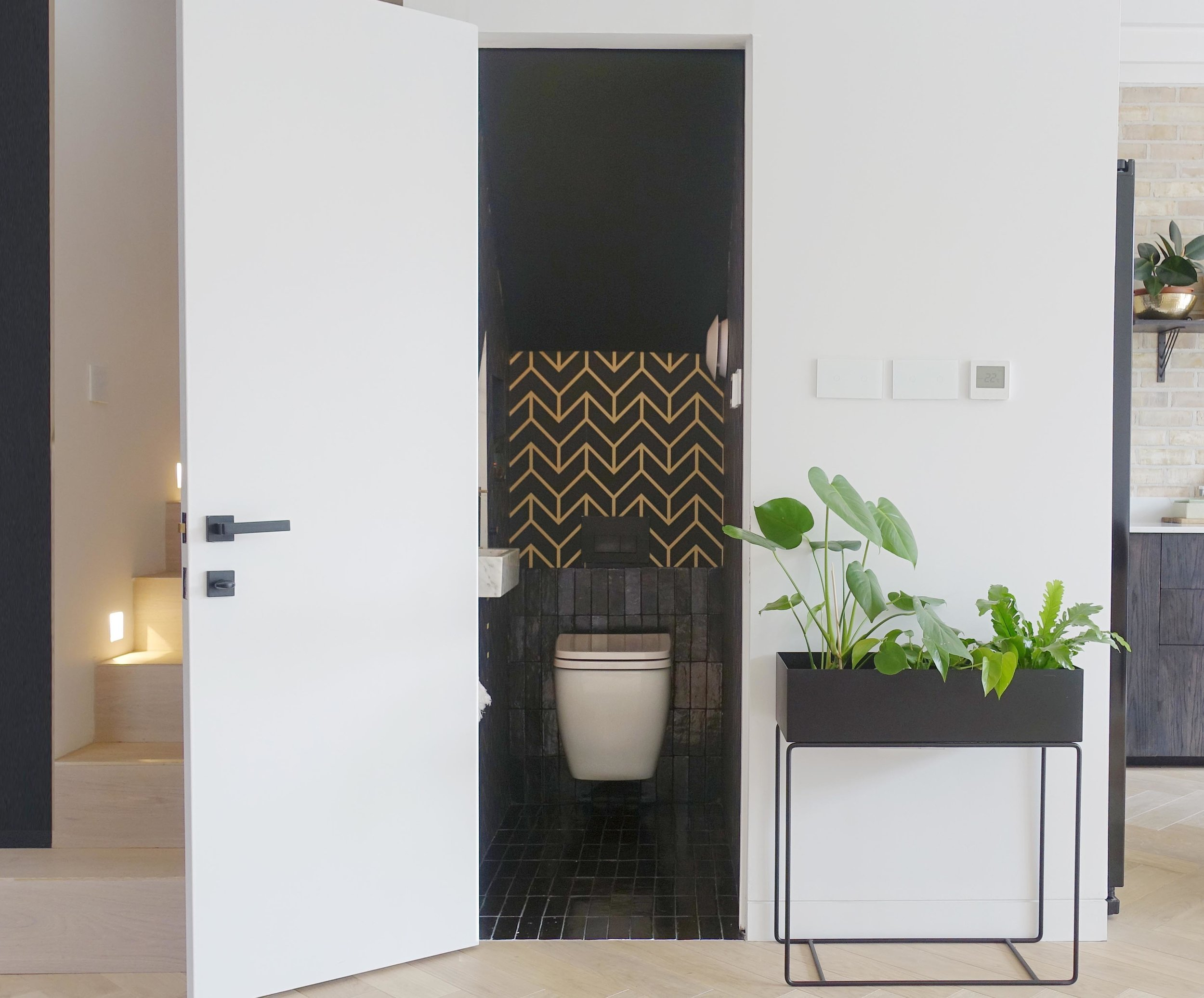 The tiny 114cm by 68cm space has been transformed into a useable guest WC