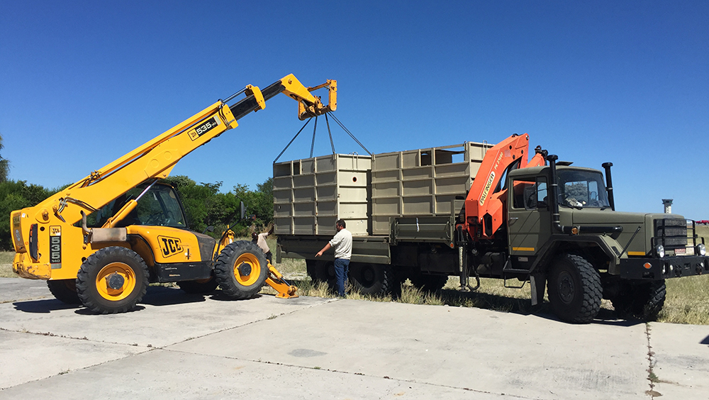 It takes seriously big trucks – and big crates – to move black rhinos around!