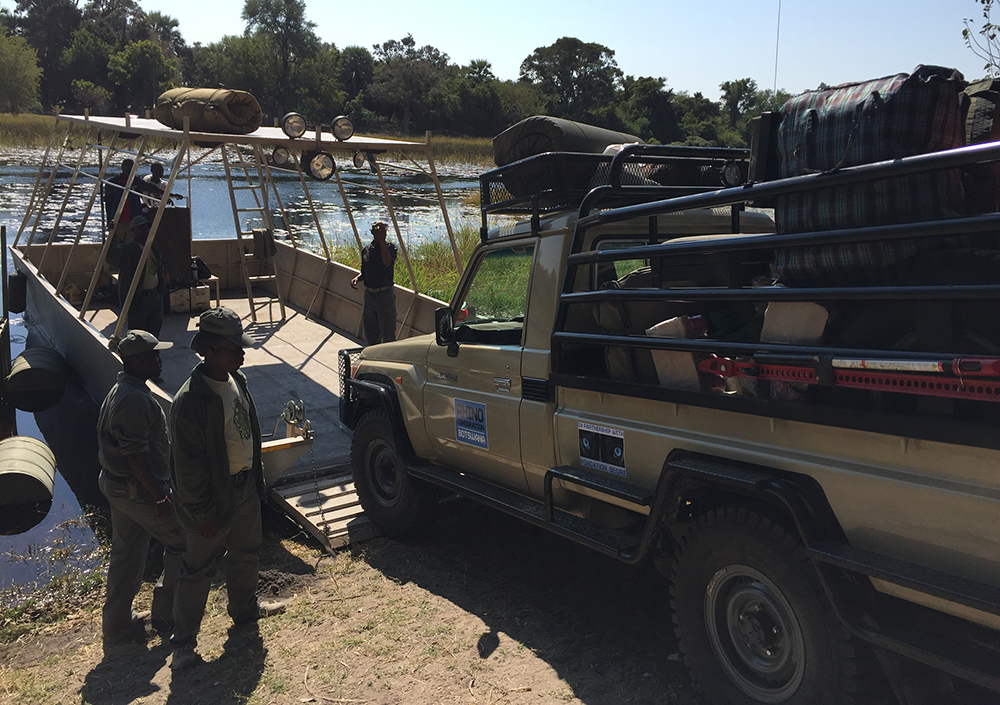 One of RCB's teams – plus vehicle – travels by water to their new rhino monitoring area.