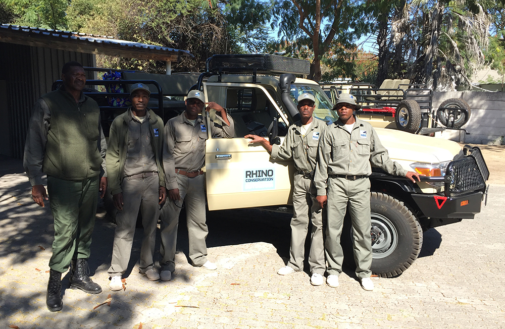 Poster (left) and RCB's new rhino monitoring officers get ready to be deployed in the field with one of our new specially adapted vehicles.