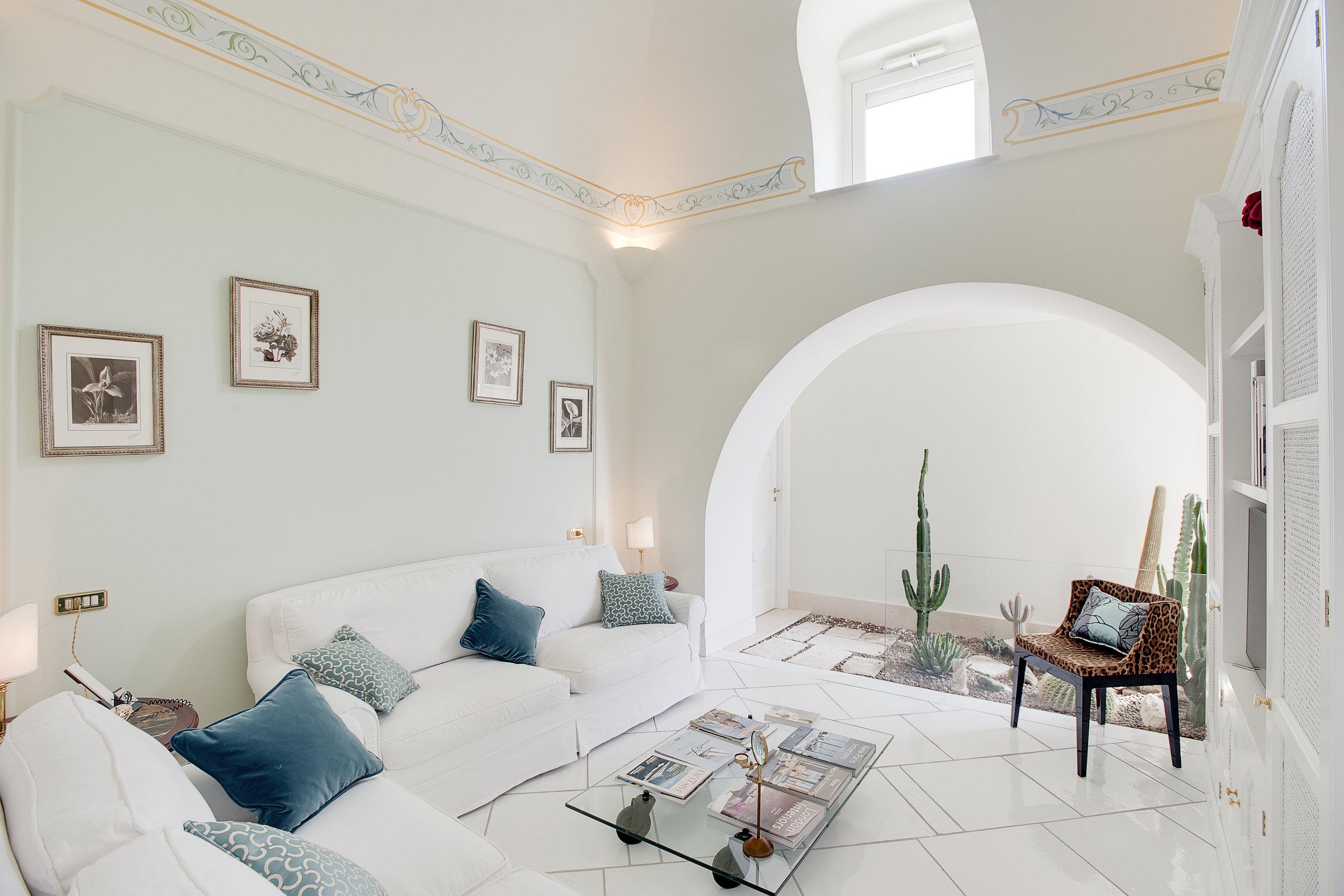 Living room of Villa Baia https://www.villaslink.com/blog/2017/3/18/walking-down-to-the-sea
