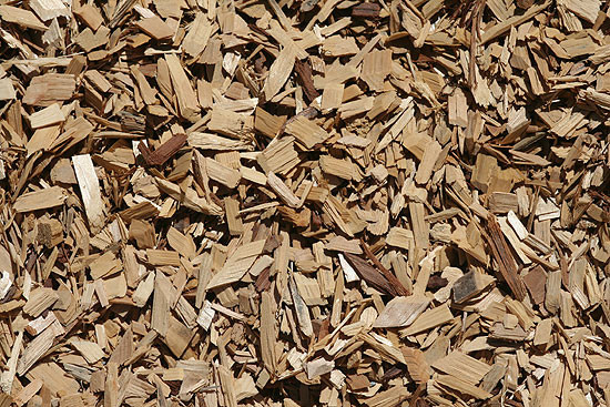 Clean virgin cedar chips, which is medium in color. A slight color variation, which is normal for naturally occurring products, adds character to your landscape. Contains blunt or soft chopped ends which are splinter free. For use in playgrounds, parks and even pathways which need to be accessible to wheelchairs.