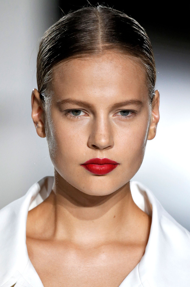 It's a red alert at Zac PosenSpring/Summer 2016. Fresh skin is teamed with matte red lips, created by make-up artist Diane Kendal.