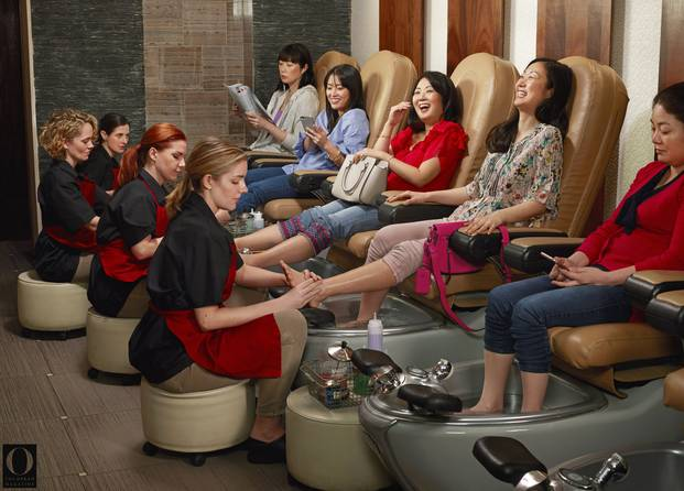 A nail salon where Asian women are having their pedicures done by white women. Source:Chris Buck/O, the Oprah Magazine