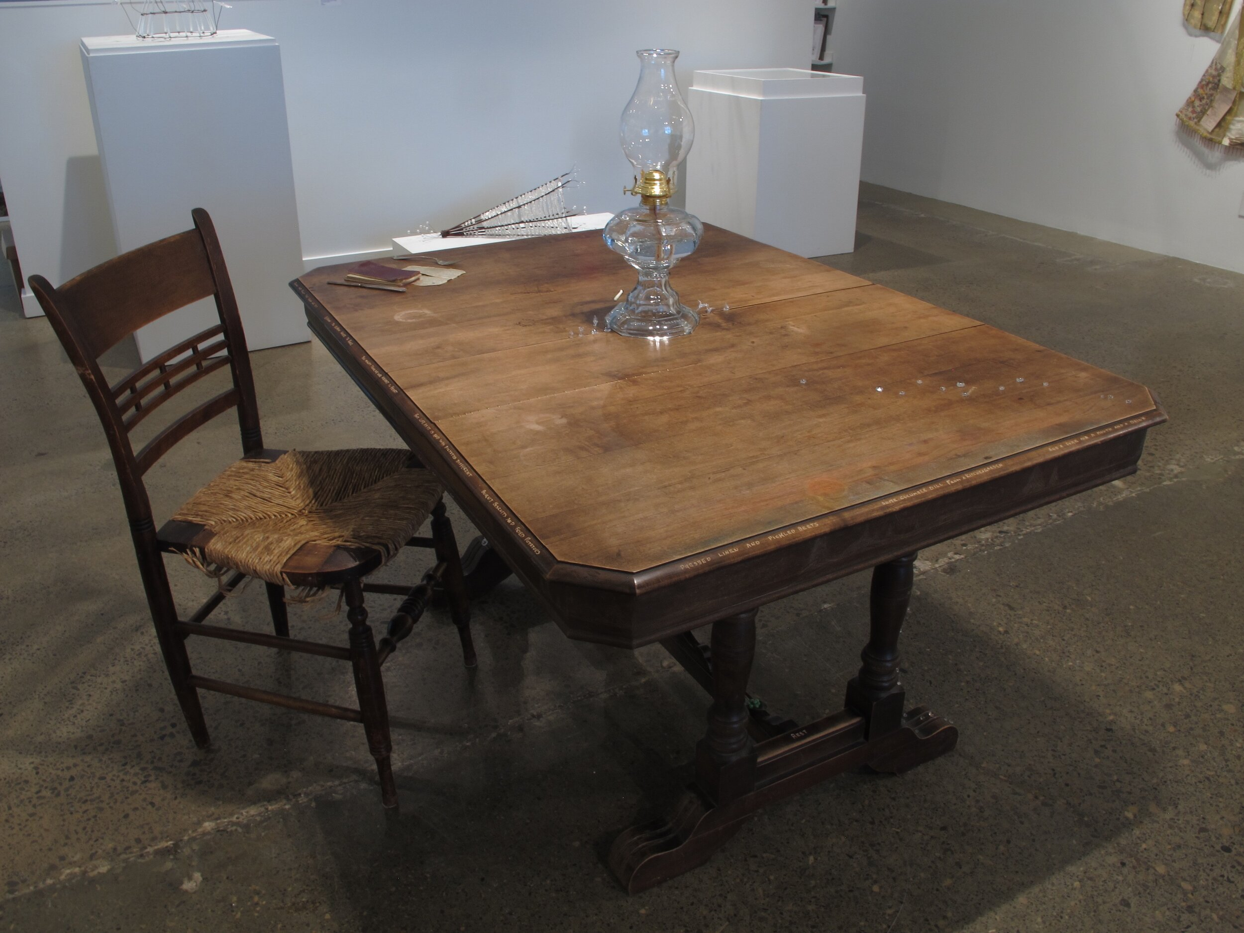 """""""Table of Tales"""" Table, natural & found objects 122 h x 102 w x 137 l cm 2019 Made in collaboration with Andy Trull, Katherine Blomquist, Jennifer Bennett Pond, Scott Pond, Tao Organ, Anya Gansterer, Sigrid Geddes, Gwen Stewart, Anna MacDonald, Megan Spencer, Steven Martyn and Emmara Lyons Grodet.  For this piece I hosted three gatherings around the table. The first and the last were full multi-course meals that I made and served. During this time we shared stories, discussed the table and reflected on the memories and feelings it held or evoked.  Table donated by Robbie Sea Van Vlaenderen"""
