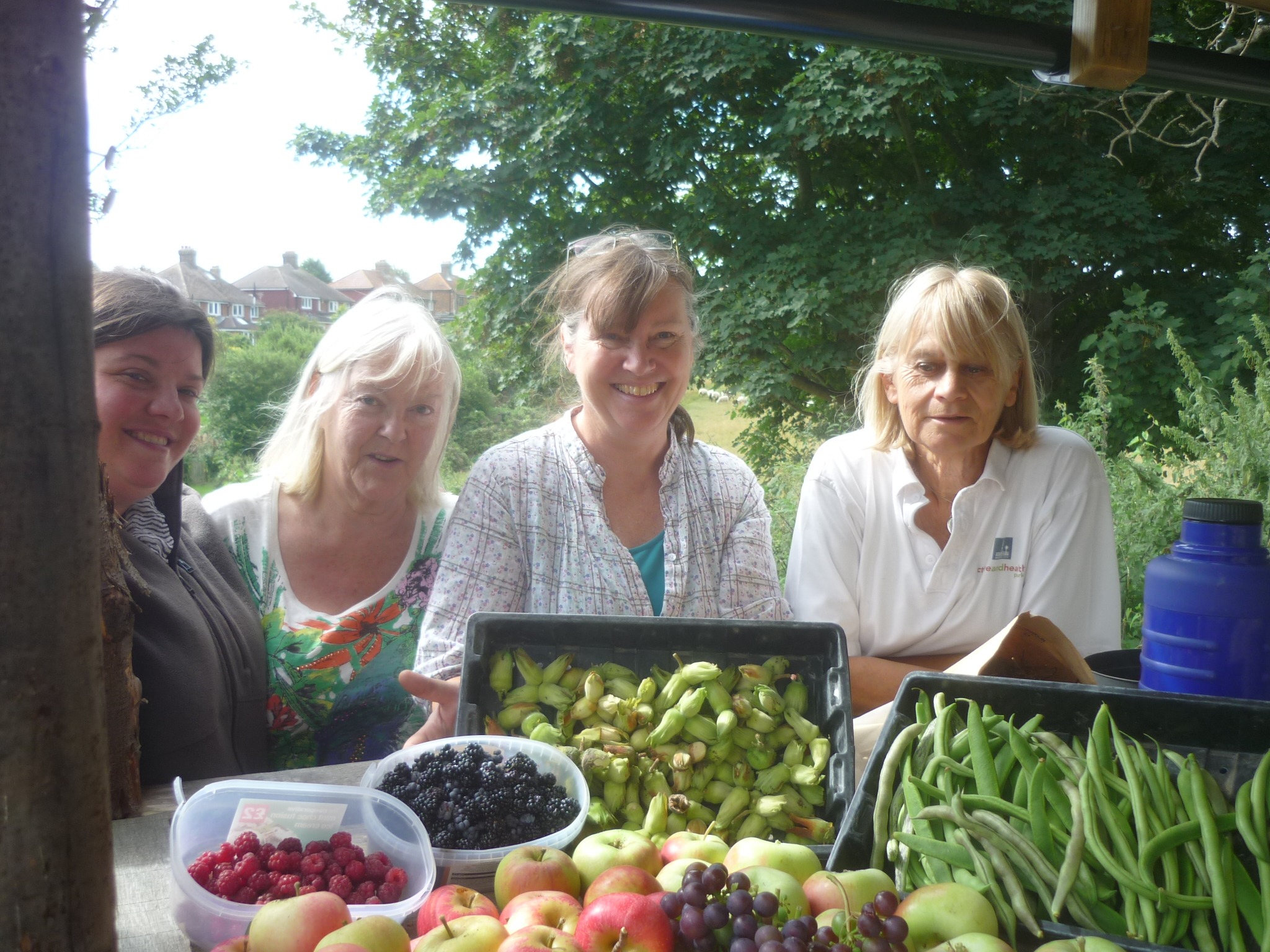 Lewes Community Allotment members with their harvest of fruit and vegetables