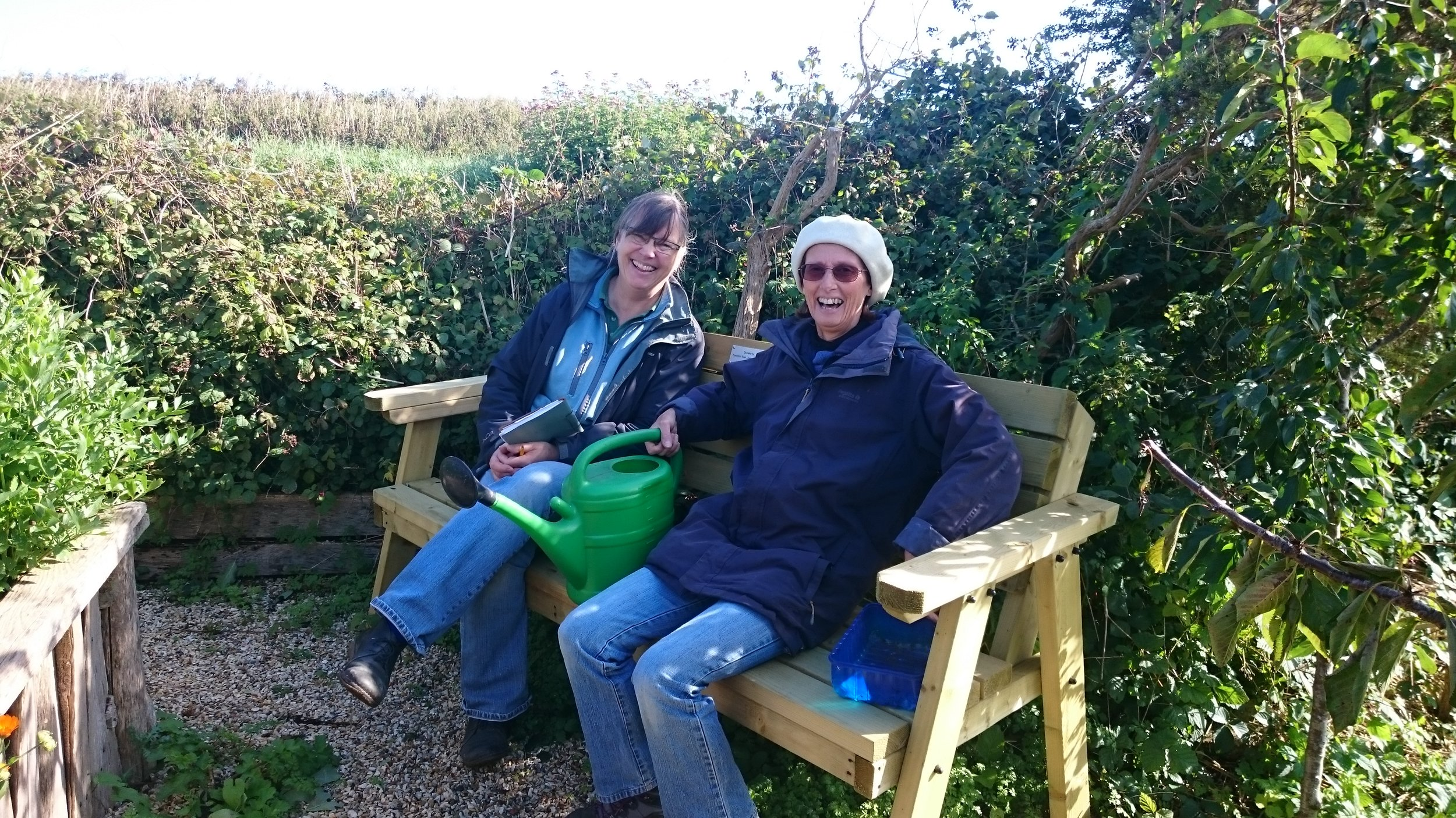 Sarah and Felicity Ann enjoy the new bench