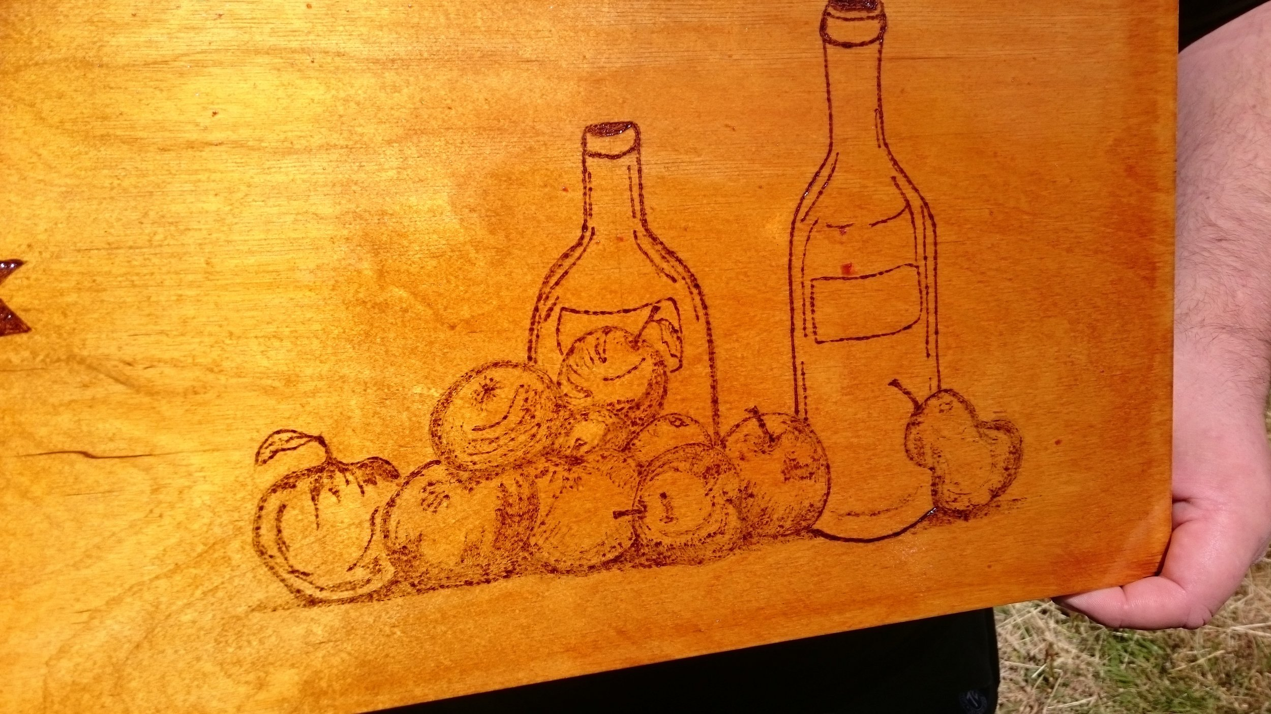 Apple and juice bottle detail