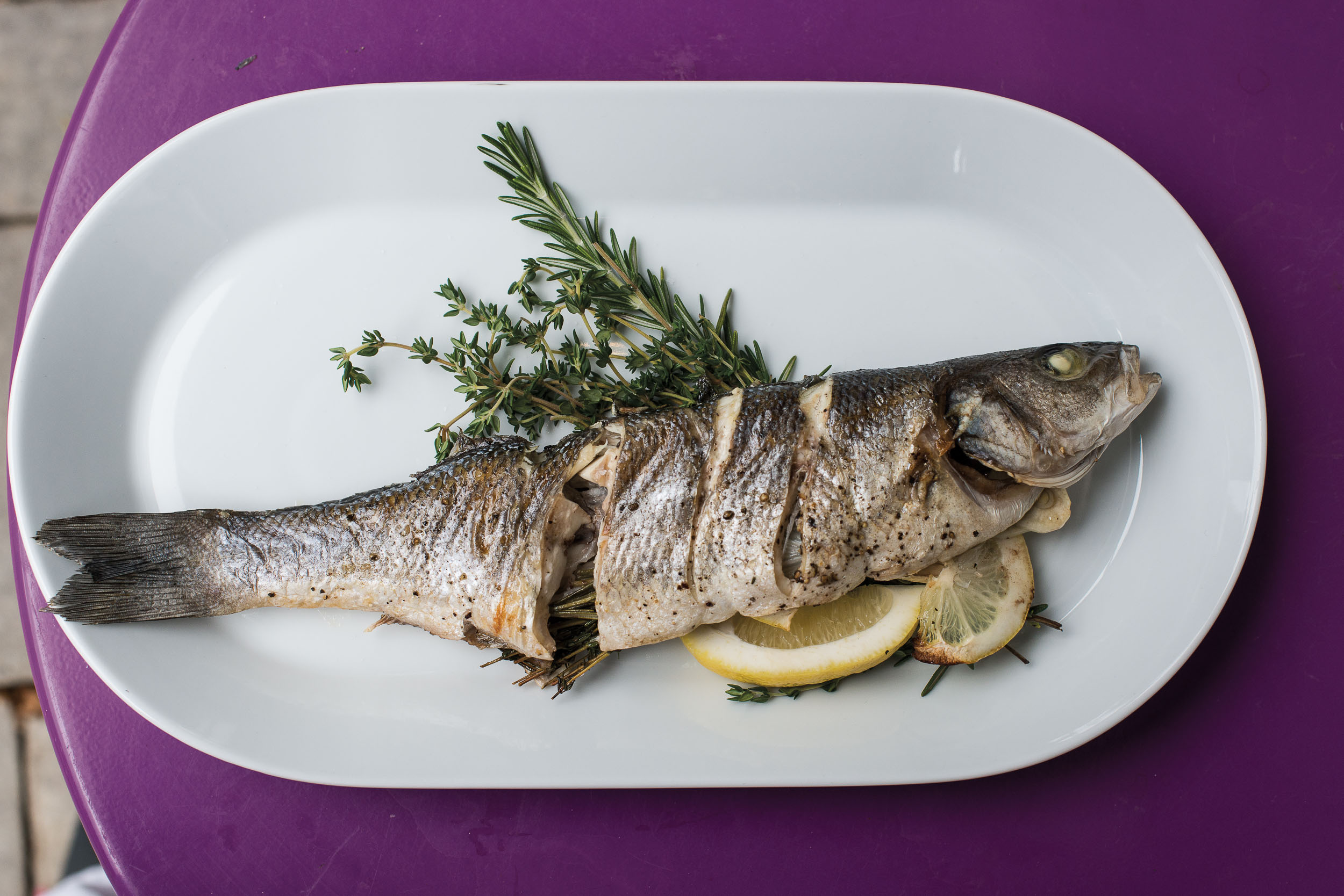 Grilled branzino with herbs and lemon