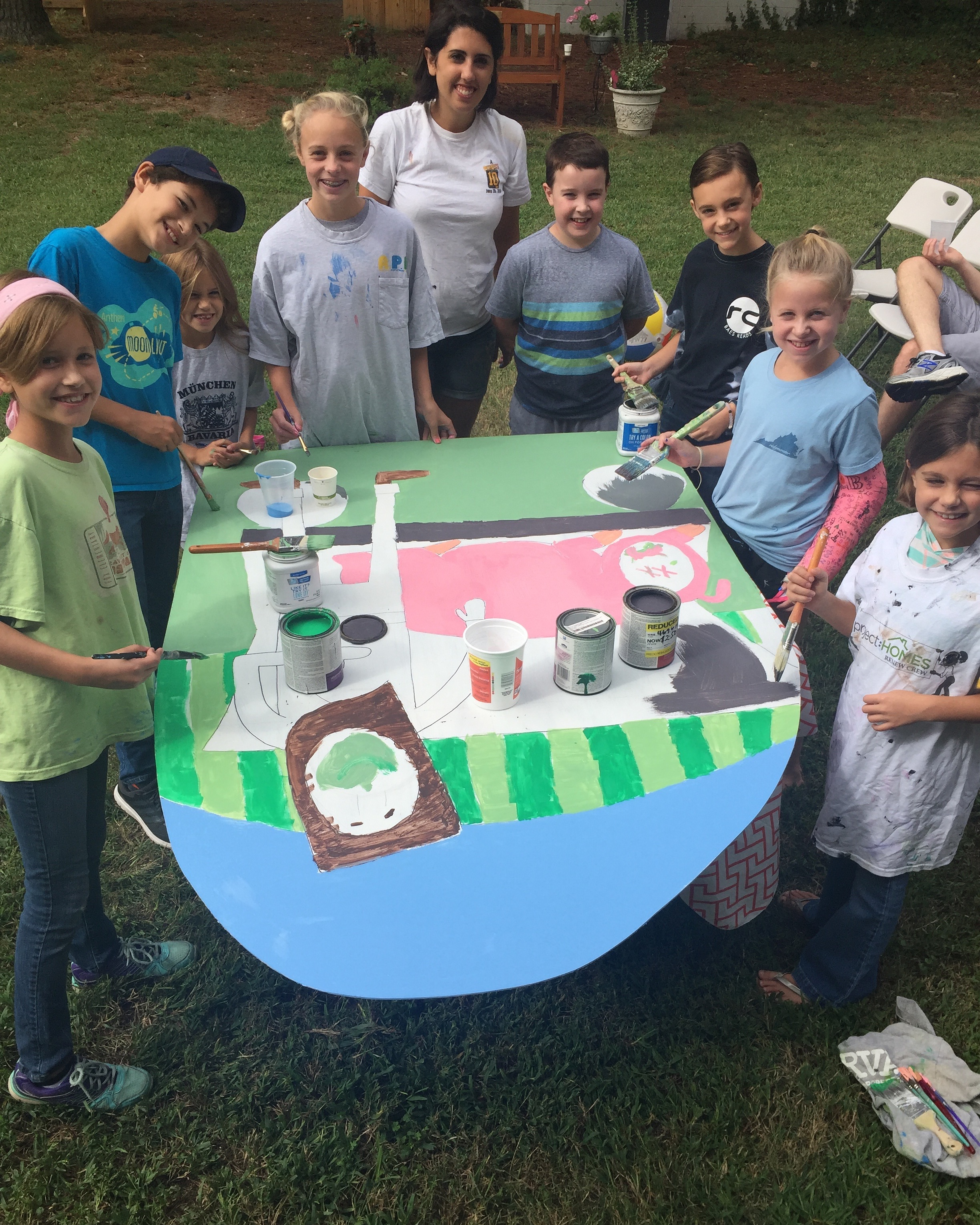 Pictured: Emily helping our  City Kids  tap into their creativity as they help prep for this year's  Harvest Party .