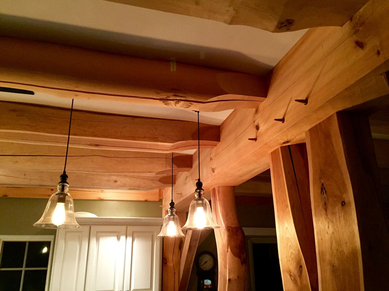 Interior timber frame lighting feature - Berkshire Mountain Design Build, LLC