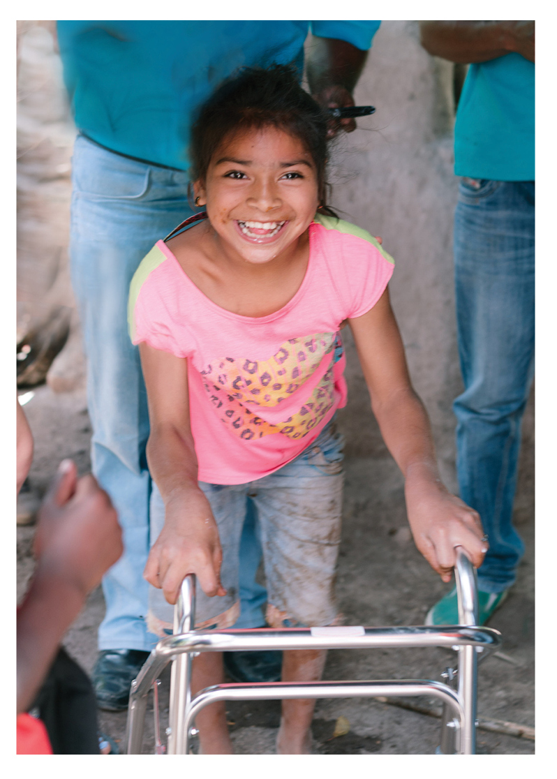 Seeing this precious girl take steps using a walker was absolutely amazing. A true success story. The Mercy Kids delivered a walker to her front door.