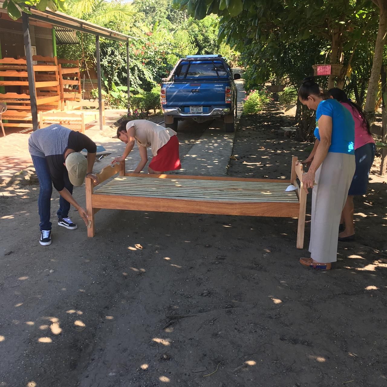 Pictured here are parents in the program sanding a bed. This helped reduce the cost of the bed. Each parent that has a child attending the center is required to give back. #teameffort