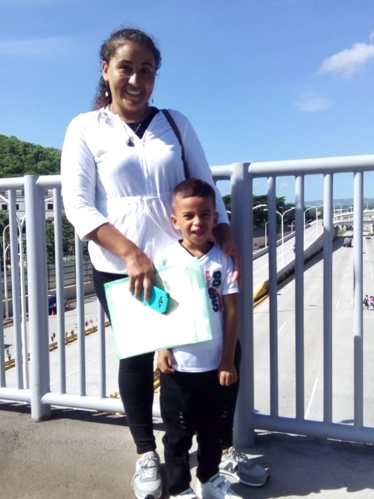 Joshua and his mom in Managua after receiving their visas