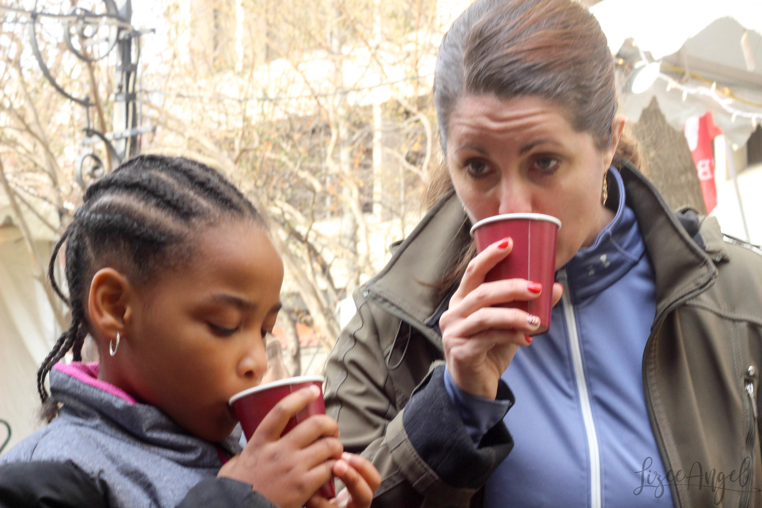 My beautiful dates for the day Jessica and my niece enjoying a hot cup of cider (spiked for Jess!) at the market