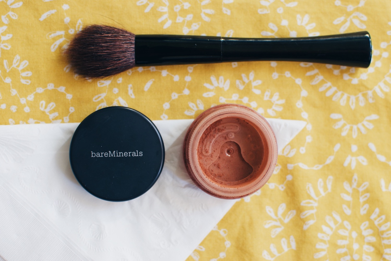 2. Face - For face makeup, I keep it extremely simple by dusting on this bronzer by Bare Minerals in the shade, warmth. I apply this to my cheeks, temples and the bridge of my nose.This product gives my skin a lovely sun-kissed look.
