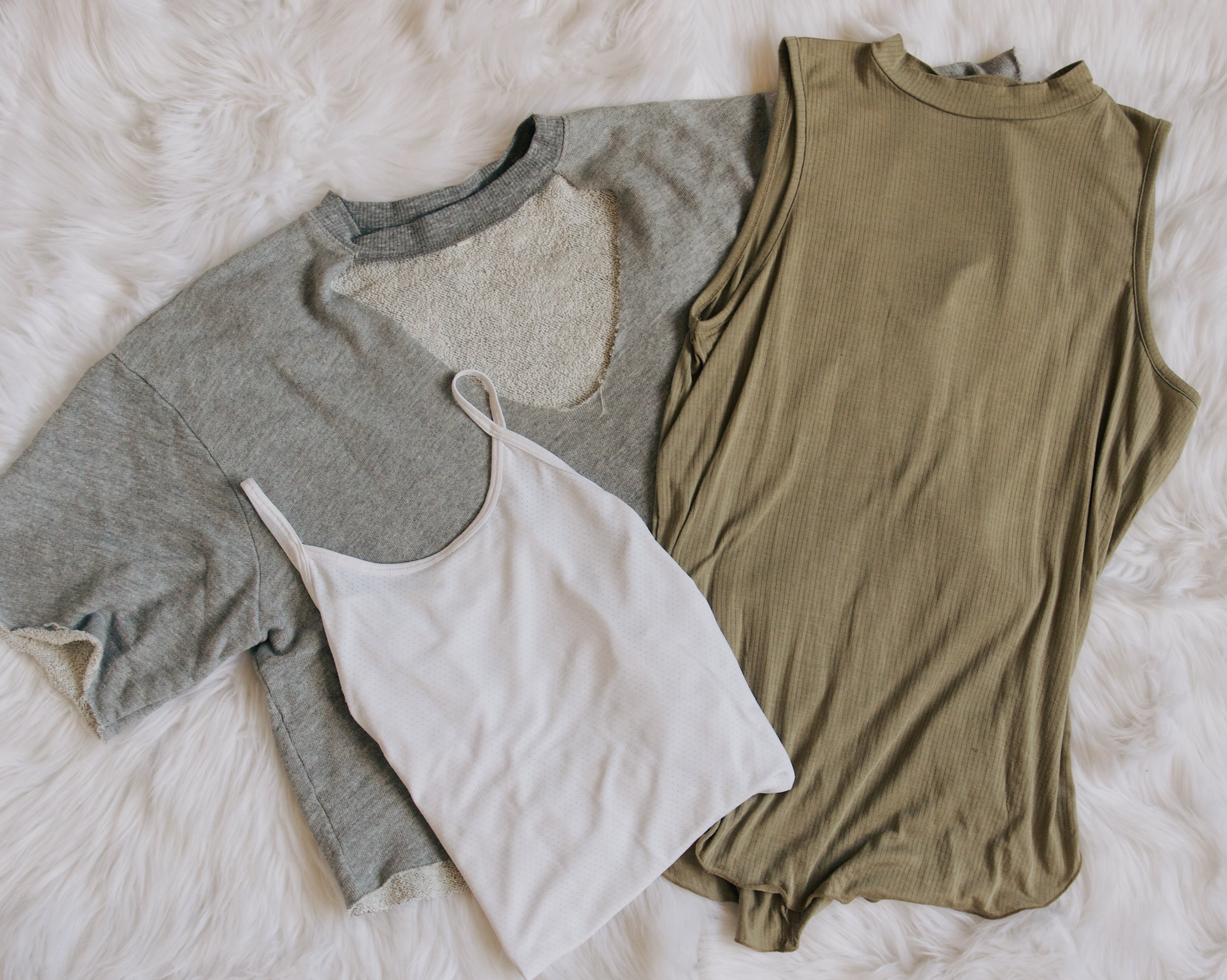 Tops - This is obvious, but bring tops that can match all of your bottoms. Again, I stuck to neutrals and know that they will match everything I have.{ grey top - urban outfitters // green shirt - urban outfitters // white tank - vimmia }