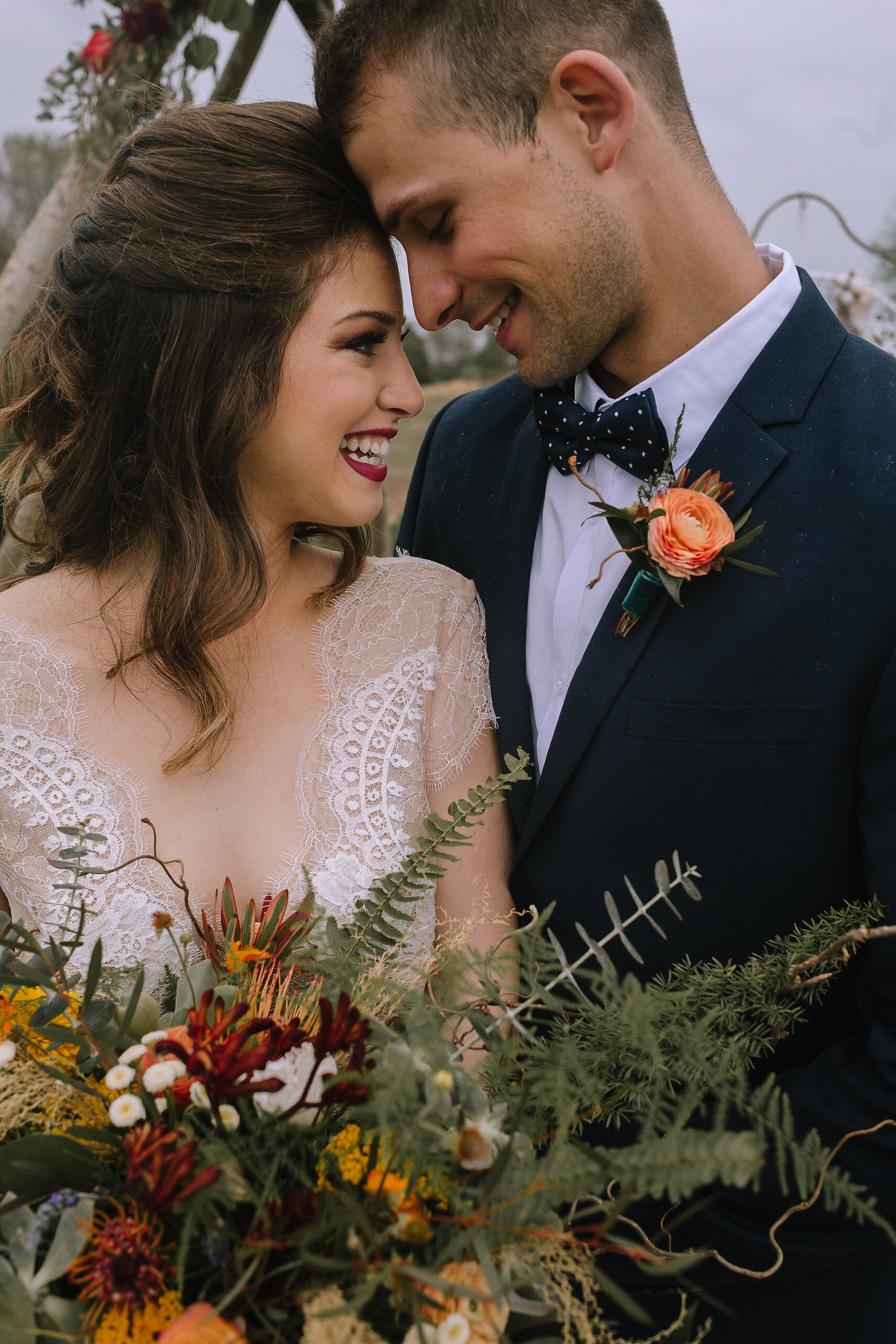 Bride and groom wearing Blanc de Blanc Bridal and H&M. Flowers from Community Flower Shop.