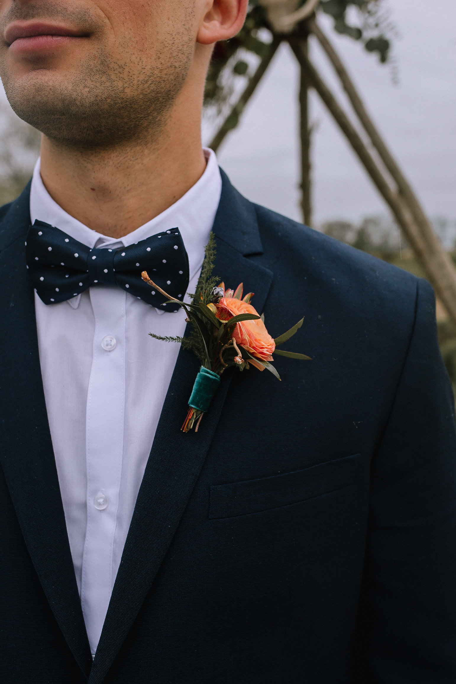 Boutineer from Community Flower Shop. Groom's suit from H&M Man.
