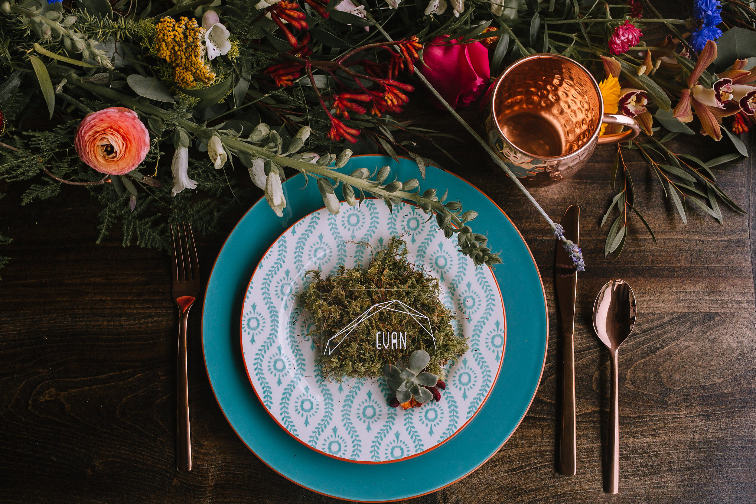 Place setting featuring dishes from Target Style, florals from Community Flower Shop and a farm table from The Wooden Whale.