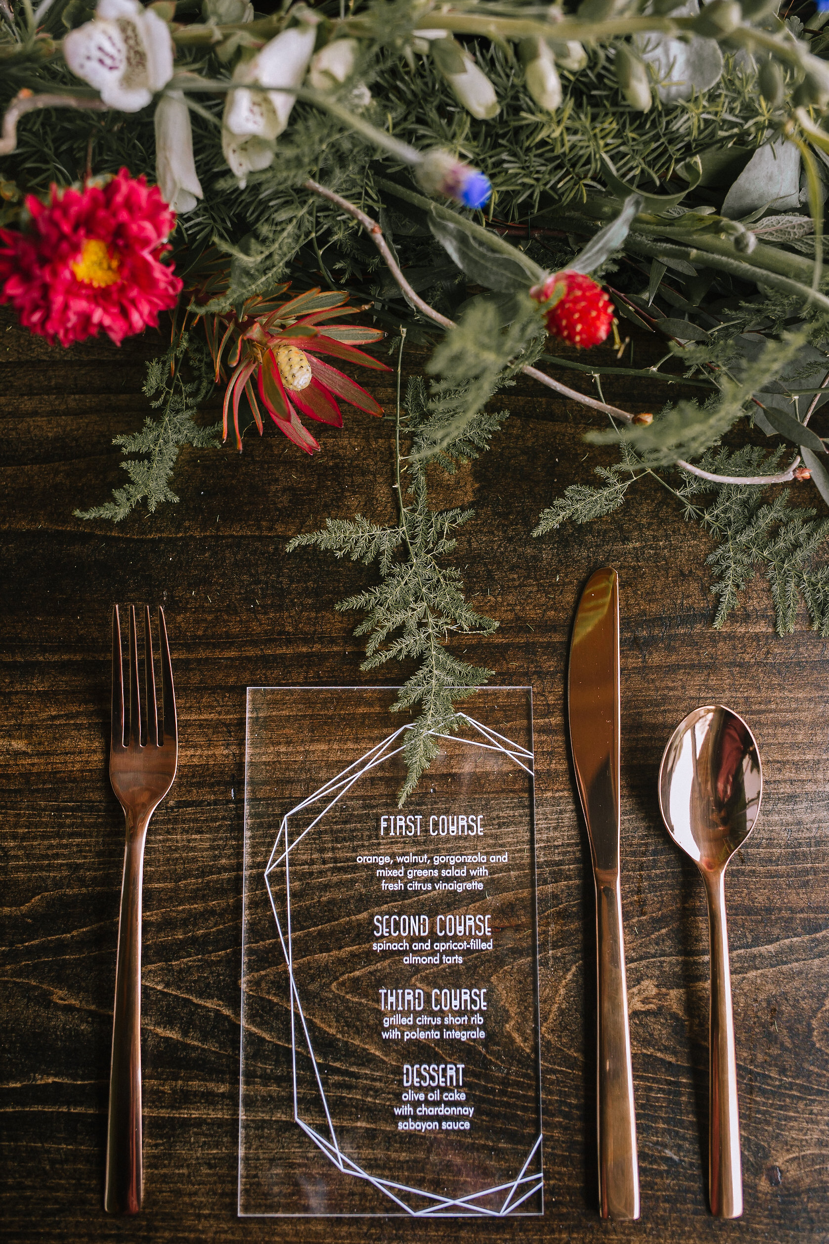 Acrylic menu from Purple Wagon Designs. Cutlery from Target. Farm table from Vintage Alley Rentals. Flowers from Community Flower Shop.