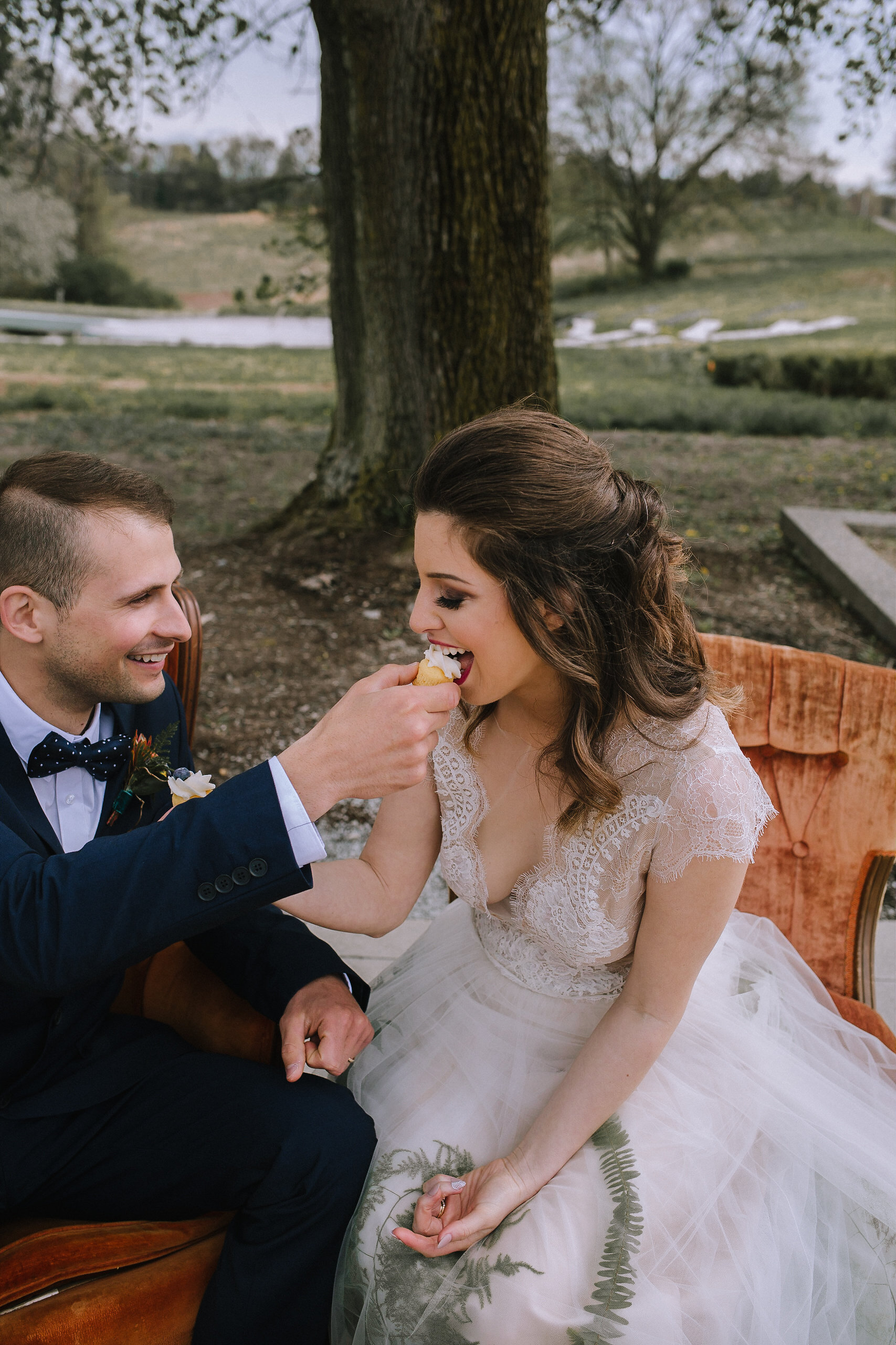 Outdoor bohemian lounge area from Vintage Alley Rentals at Chatham University, Eden Hall Farm designed by Exhale Events. Bride's look from Blanc de Blanc Bridal, Melissa Gown by Divine Atelier. Groom's suit from H&M.