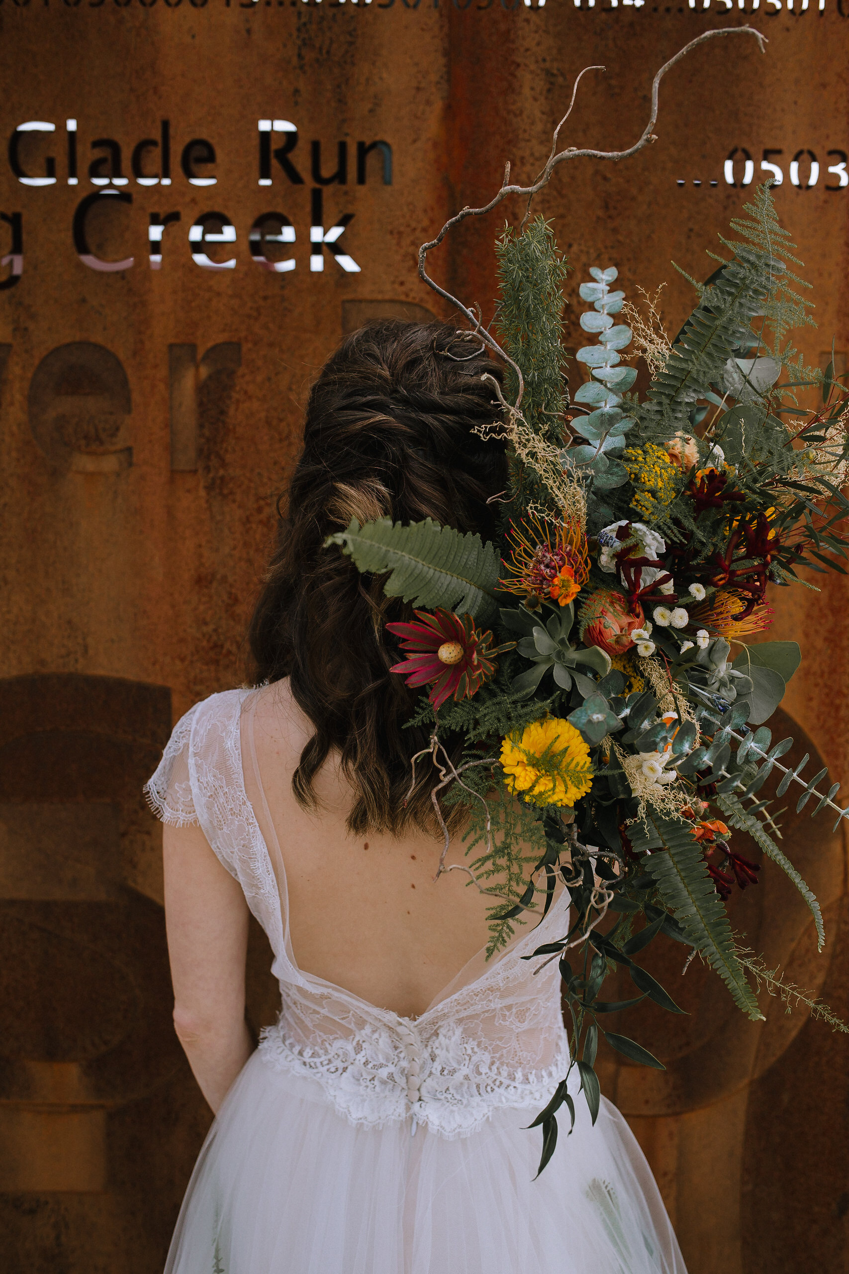 Bohemian wedding at Chatham University, Eden Hall Farm designed by Exhale Events. Bride's look from Blanc de Blanc Bridal, Melissa Gown by Divine Atelier.Bridal bouquet from Community Flower Shop. Hair & makeup by JL Makeup Studio.