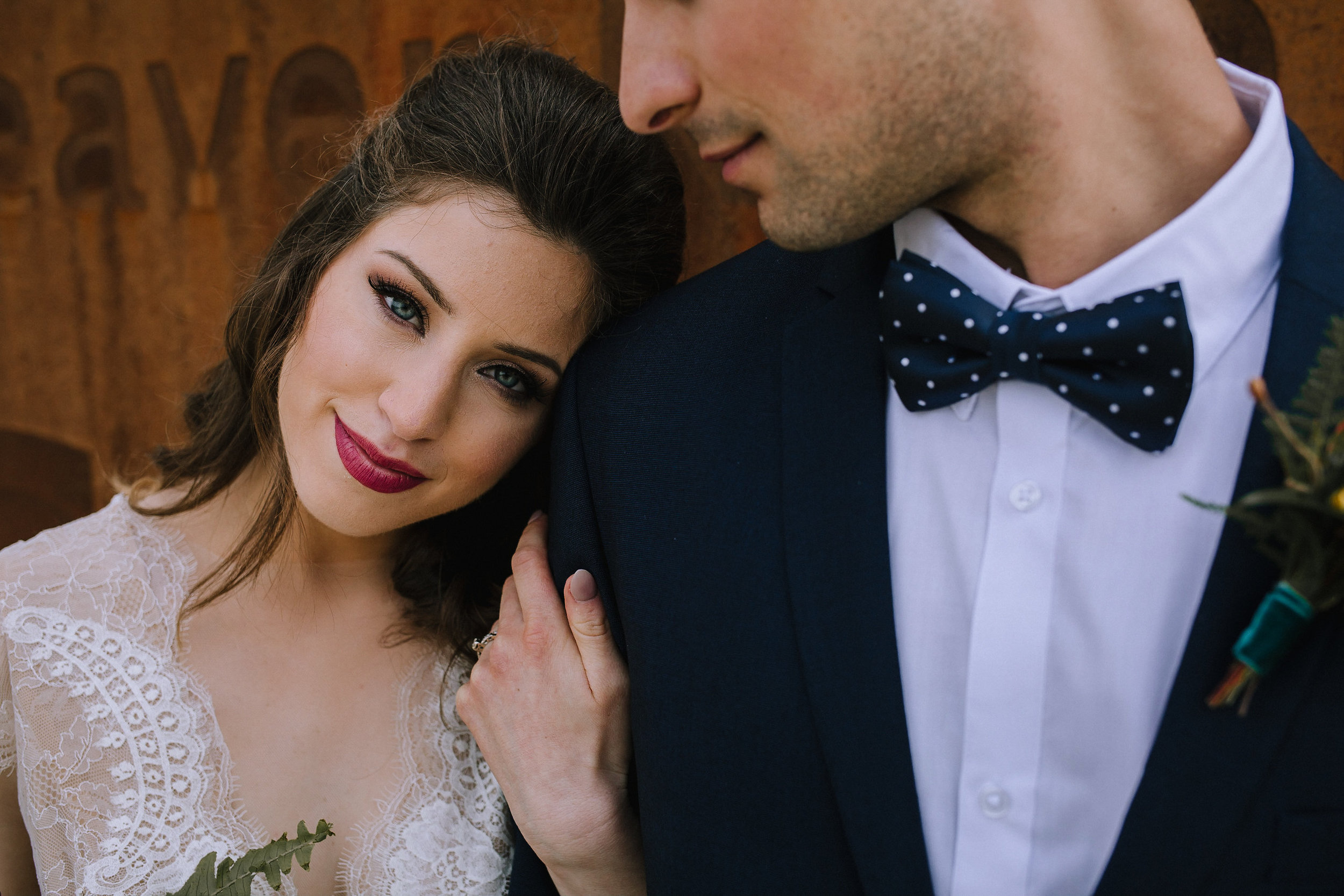 Bohemian wedding at Chatham University, Eden Hall Farm designed by Exhale Events. Bride's look from Blanc de Blanc Bridal, Melissa Gown by Divine Atelier. Groom's suit from H&M. Hair & makeup by JL Makeup Studio.
