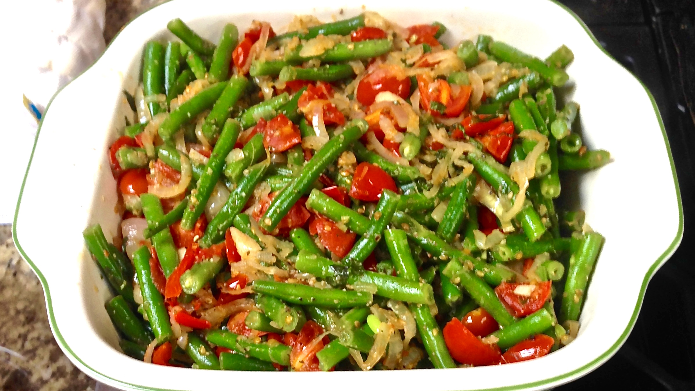 Green Beans sautèed with shallots, cherry tomatoes, and red peppers… tossed in a lemon, garlic-butter. So good!