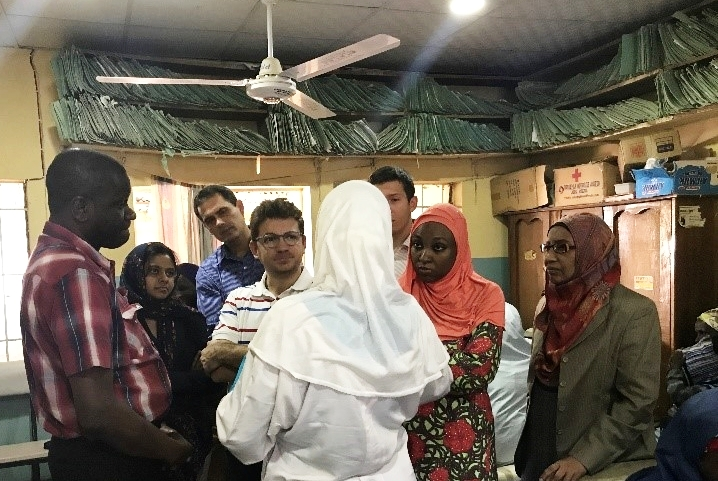 Stephen Obaro (IFAIN), Umut Gurkan (CWRU)and the Hemex Health team visiting a Nigerian SCD clinic. Patient files line the shelves near the ceiling.