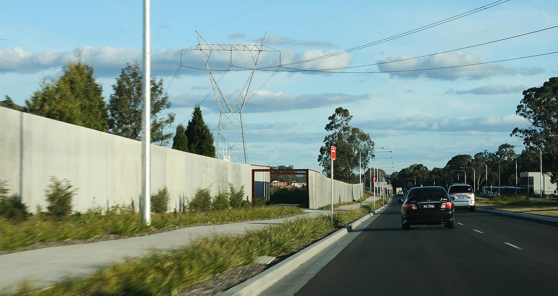 pedestrian access through sound wall.jpg
