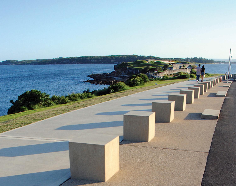 1-view south along coastal walk with bollards and dividing strips.jpg