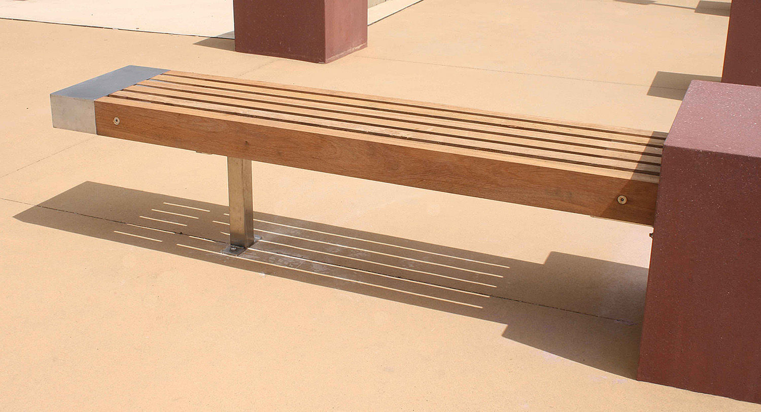 11-custom designed timber bench seating incorporate with bollards.jpg