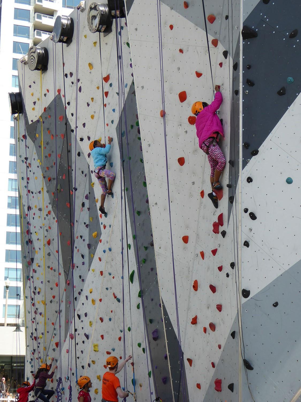Children on rock climbing structure