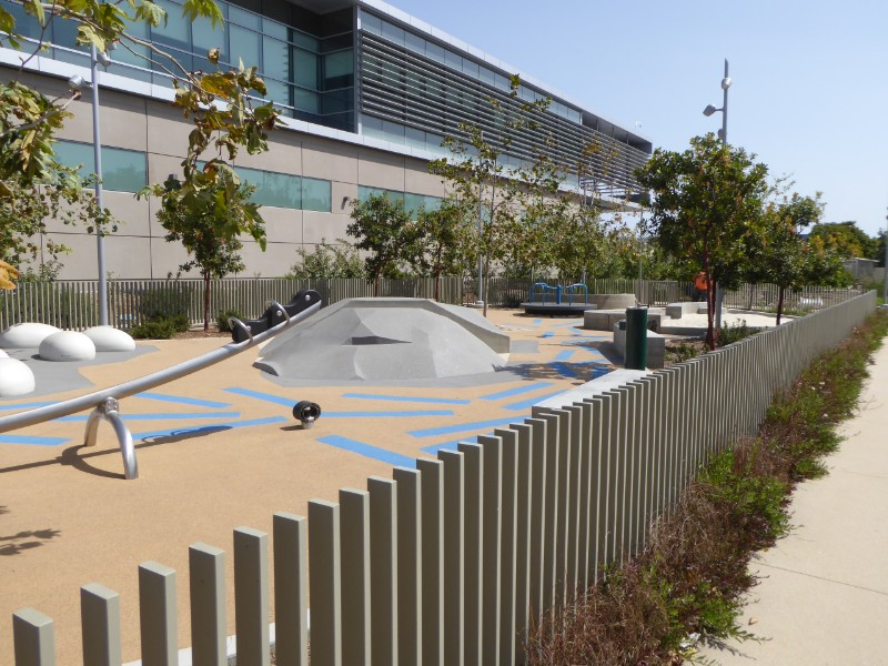 Playground, steel fence & wall of Metro maintenance building