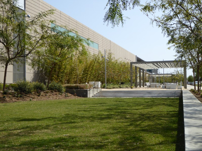 Sunken lawn area + shade structure + wall of Metro maintenance building