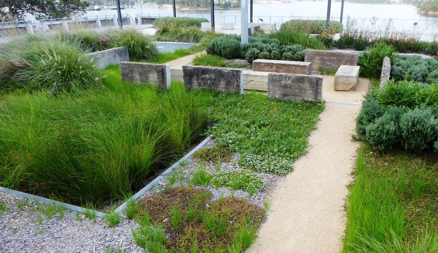 20. Garden with recycled material at south end of platform.JPG