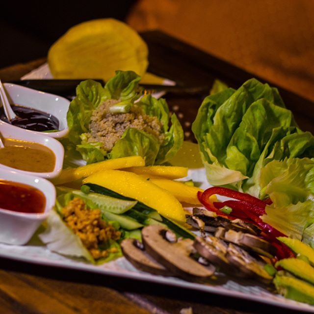 Lettuce Wraps | Make your own Fresh Rolls with Lettuce Leaves, Avocado, Cucumber, Bell Peppers, Mango, Portobello Mushroom, Quinoa, Crispy Fried Noodles and Roasted Peanuts served with dipping sauce.  Come experience a new philosophy in Nightlife.  The Karma Nighttime Menu is available every Thursday - Saturday | 6-10pm  #vegan #vegetarian #YXE #glutenfree #nightlife #dtnyxe #karma #plantbased