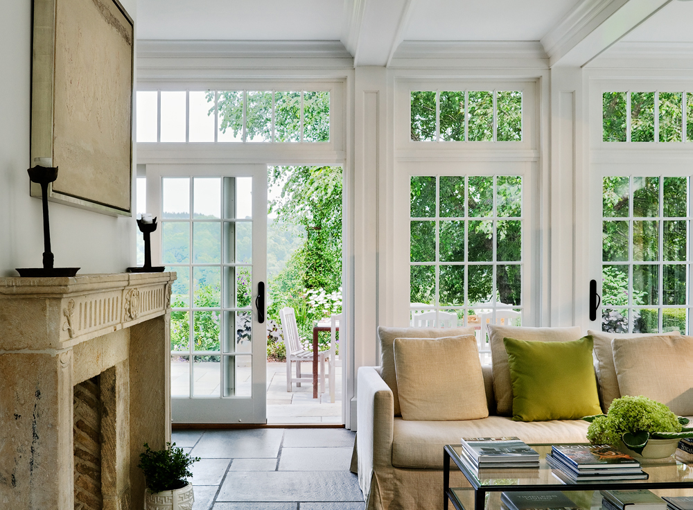 French Doors with Transoms -  When trying to make a small room feel substantial, we find that light and architectural details go a long way.